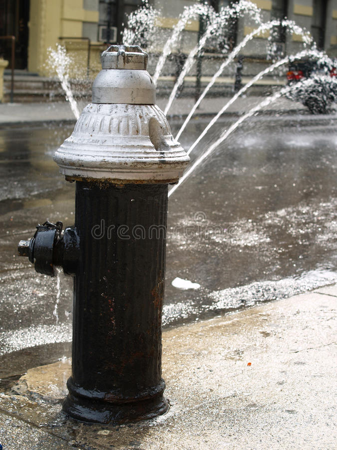 Open Fire Hydrant. On a hot summer day in the streets of NYC royalty free stock photos
