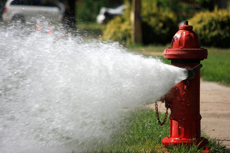 Open Fire Hydrant Gushing High Pressure Water royalty free stock image