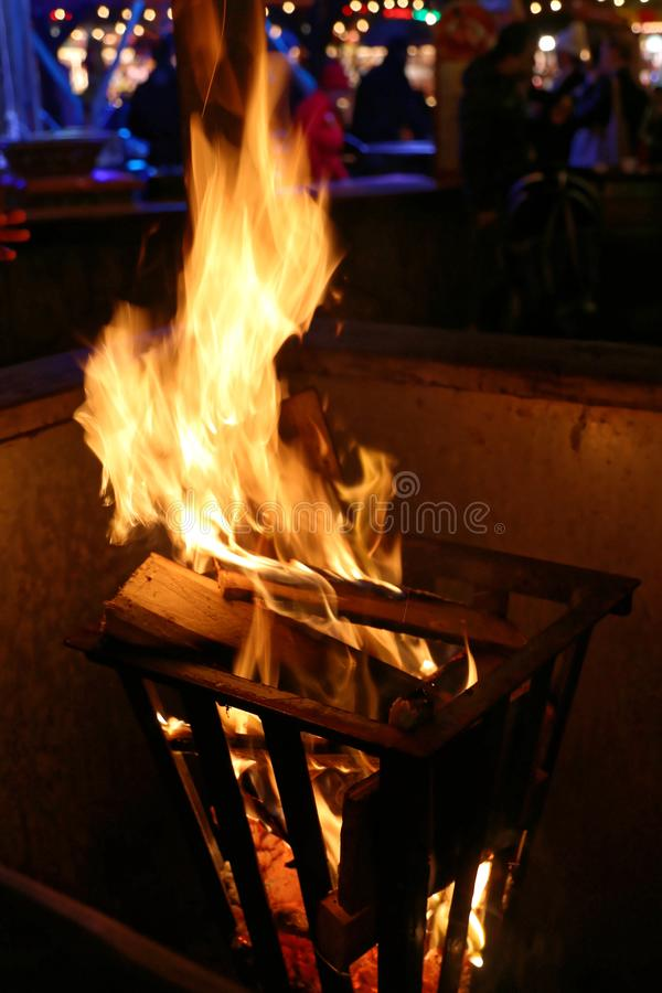 Open Fire. Log Fire in Metal Firepit at Winter Fair stock image