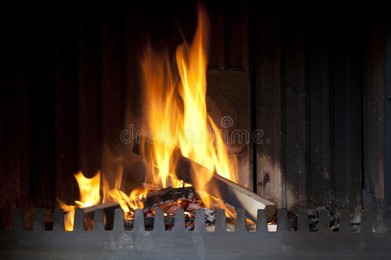 Open fireplace with fire. Open cast iron fireplace with hot fire stock photos