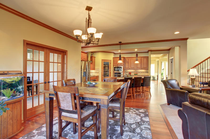 Open floor plan dining area connected to kitchen and living room royalty free stock photo