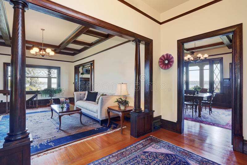 Open floor plan of living room and dining room in old style house. royalty free stock photos