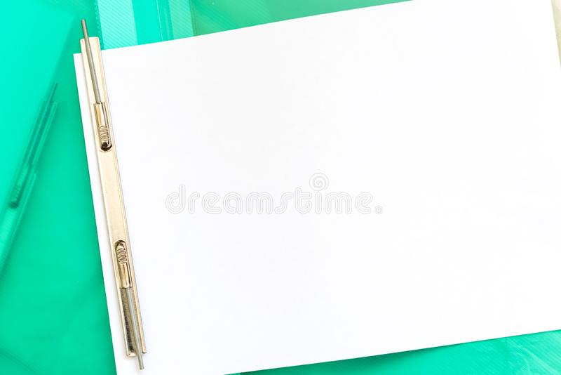 Open folder with metal clip for papers. Office tools. Copy space stock image