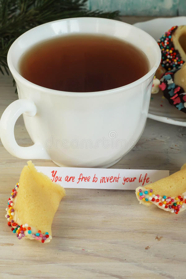 Open fortune cookie happy new year and tea stock photo