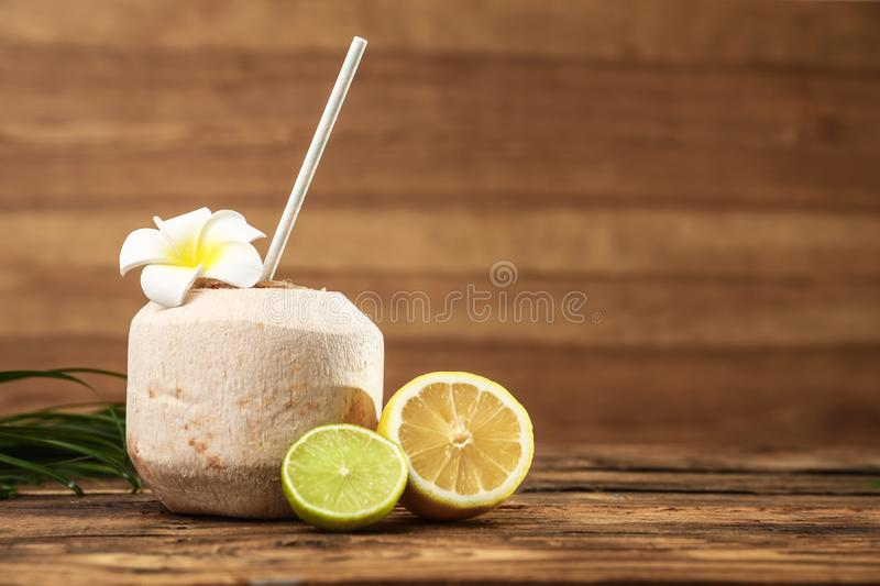 Open fresh coconut and citrus fruits on table. Space for text. Open fresh coconut and citrus fruits on wooden table. Space for text royalty free stock photos