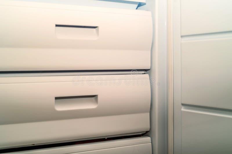 Open fridge freezer. With several freezing chambers royalty free stock photo