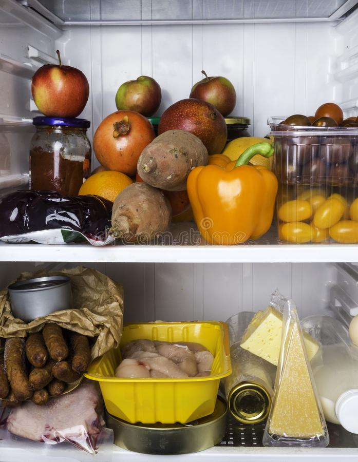 Open fridge full of fresh fruits and vegetables, healthy food background, organic nutrition, dieting royalty free stock image