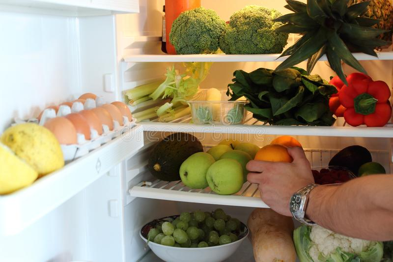 Open fridge full of vegetables and fruits. Healthy fridge. stock photo