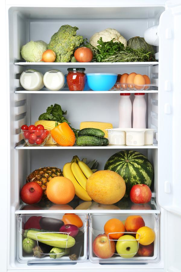 Open fridge. Full of vegetables and fruits stock photography