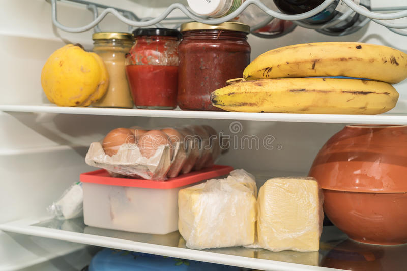 Open fridge with usual food royalty free stock photo