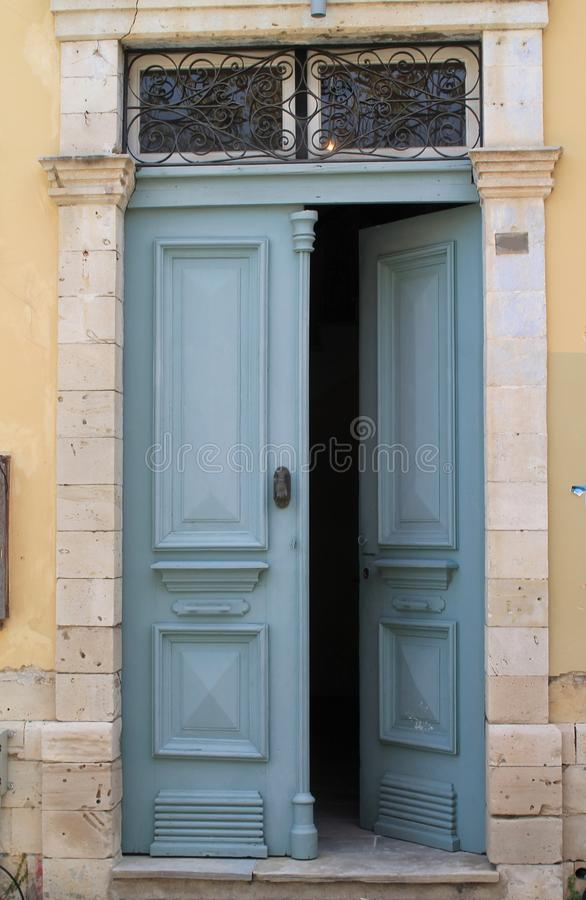 Open front door in stone wall royalty free stock photos