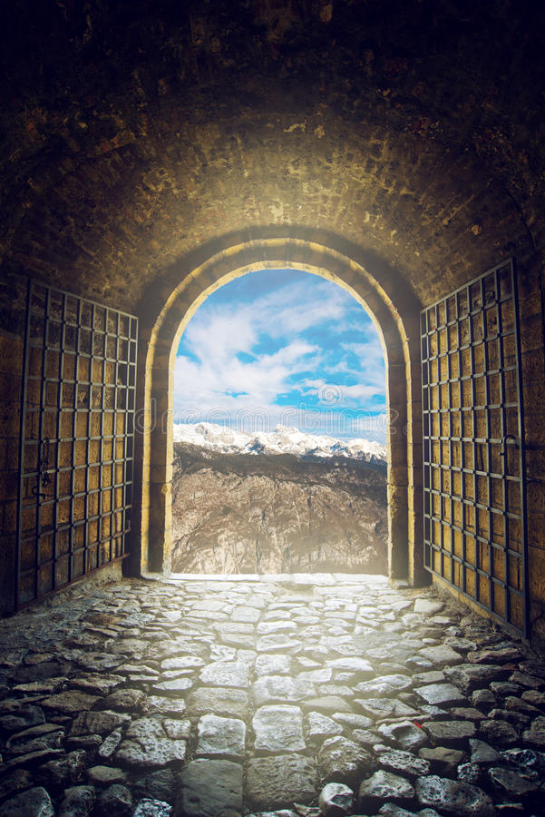 Open gate with mountain range view royalty free stock image
