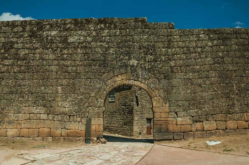 Open gate on a stone outer wall. Open gate arch on a stone outer wall in a sunny day, at the historic city center of Sortelha. One of the most astonishing and stock photos