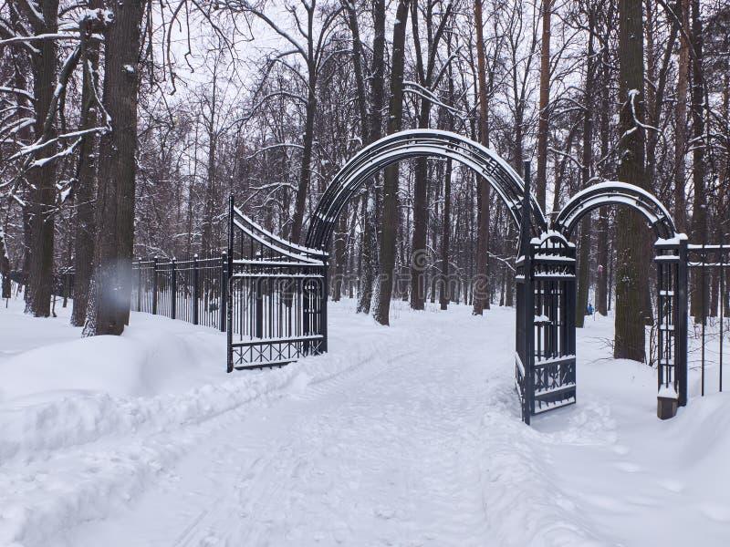 Open gates to snow covered city park.  stock photos