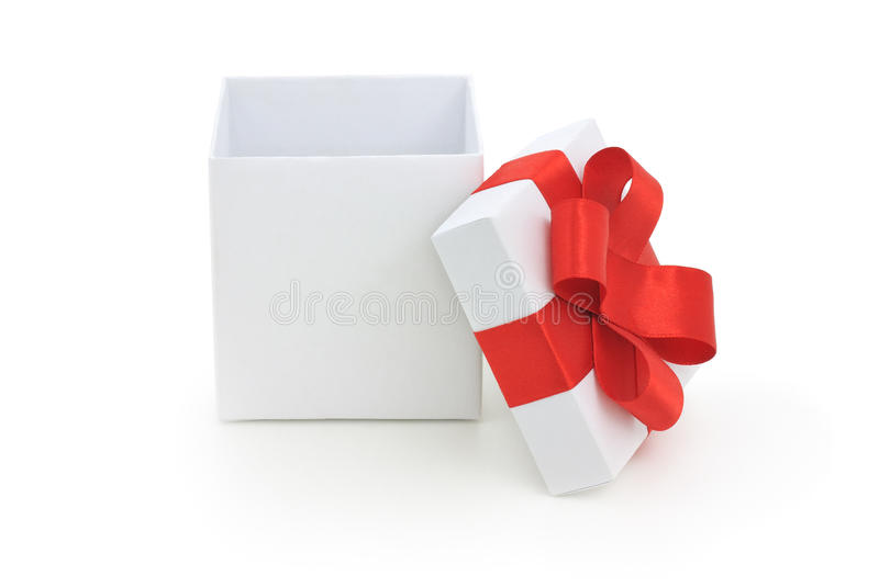 Open gift box. Open empty gift box and red bow. Isolated royalty free stock images