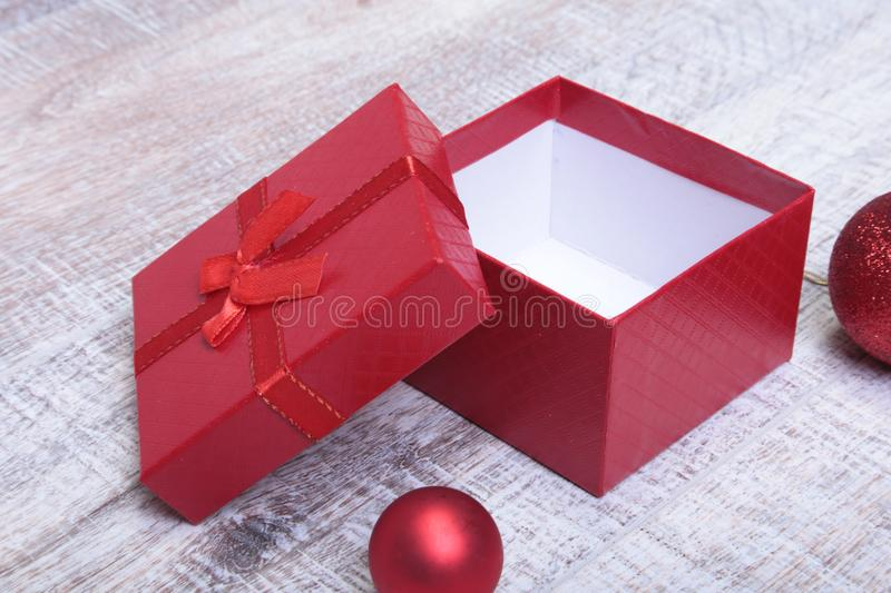 Open gift box with christmas ball, on the white background stock photography