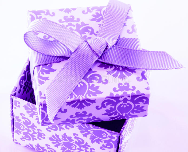 Open gift box. A close up of decorative cardboard gift with a fabric bow stock images