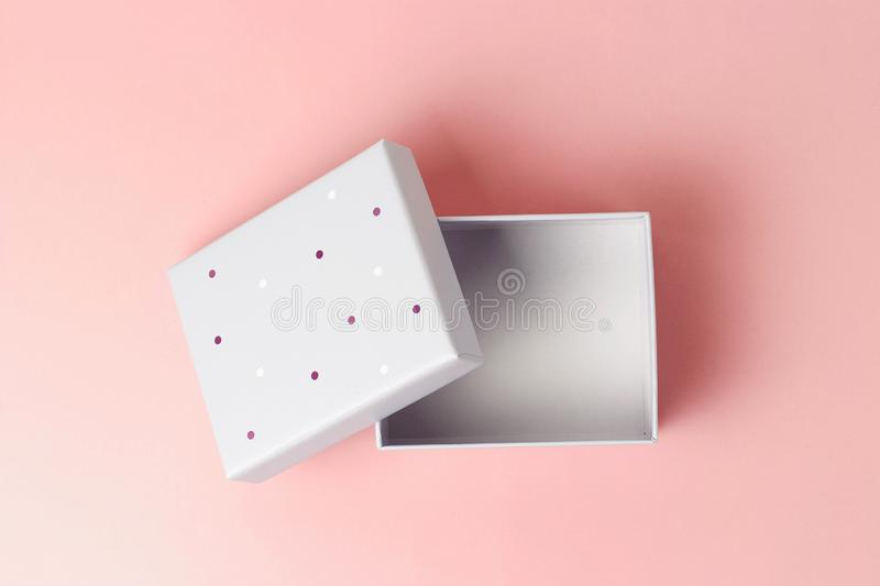 Open Gift box on a pink background close-up, top view stock photography