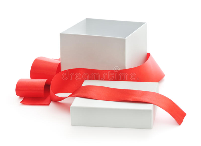 Open gift box. Open gift box with red ribbon on white royalty free stock photography