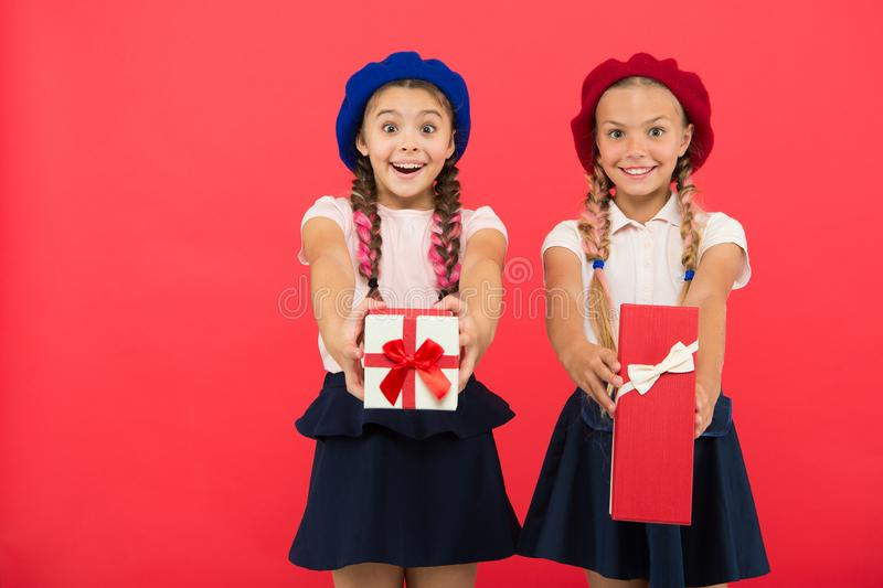 Open gift now. Friendship concept. Birthday present. Shopping and holidays. For my dear friend. Girl giving gift box to. Friend. Girls friends celebrate holiday stock images