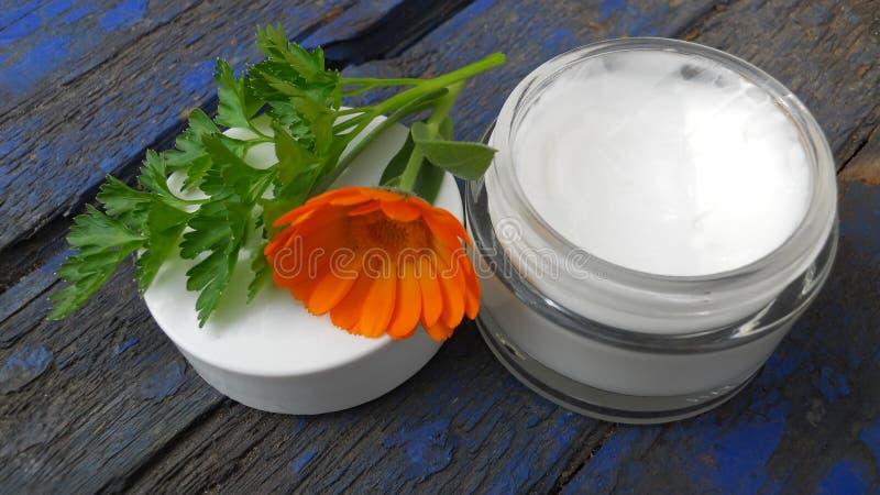 open glass jar with white cream stock photos