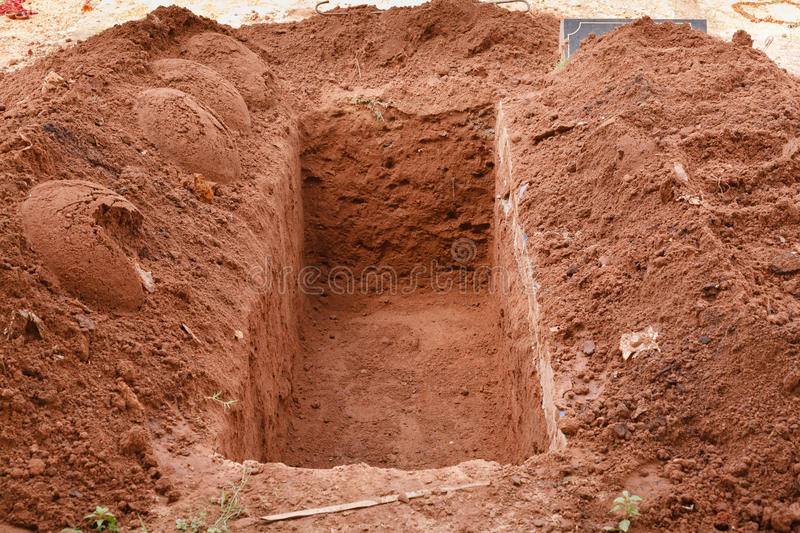 Open grave stock photography
