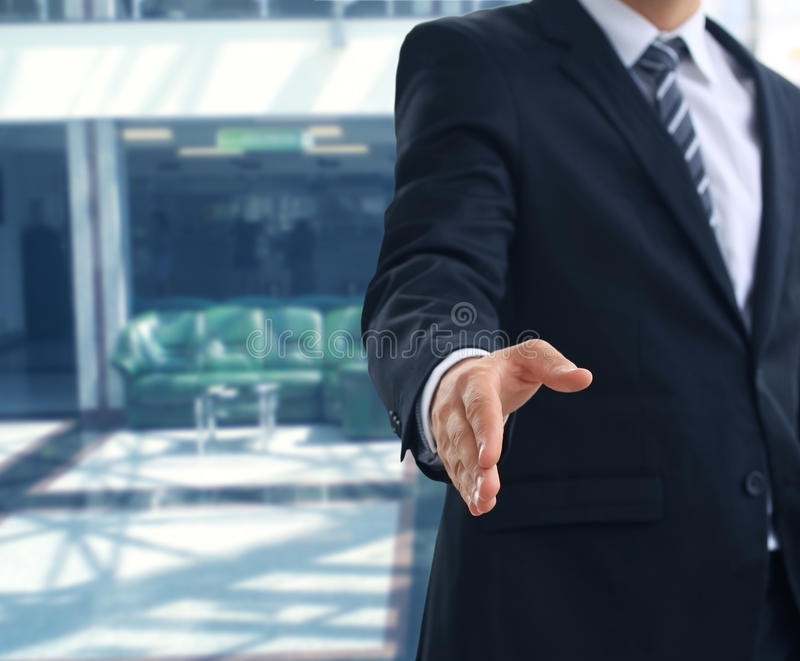Open hand. A business man with an open hand ready to seal a deal stock photos