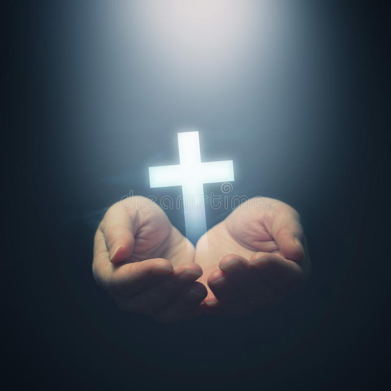 Open hands holding Christianity cross royalty free stock images