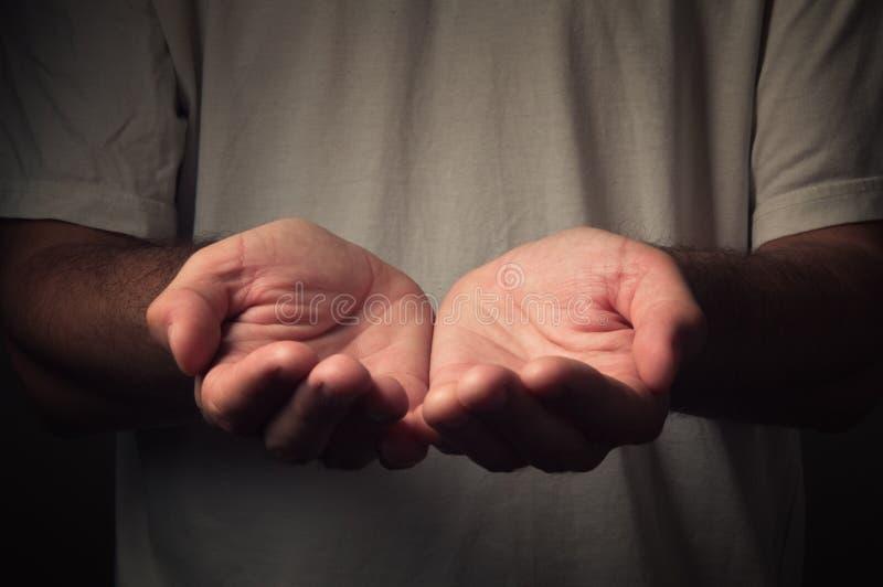Open hands of a man stock photos