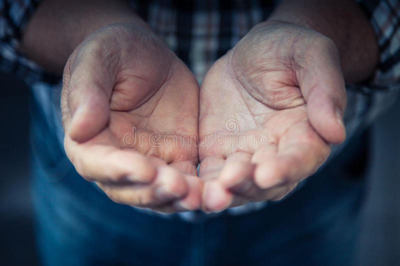Open hands. Of an old man stock photography