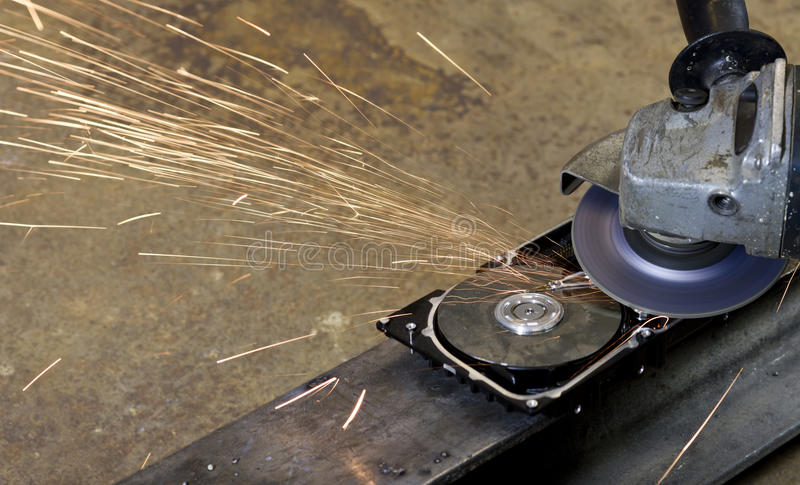 Open hard disk with circular saw. In rusty background royalty free stock photo