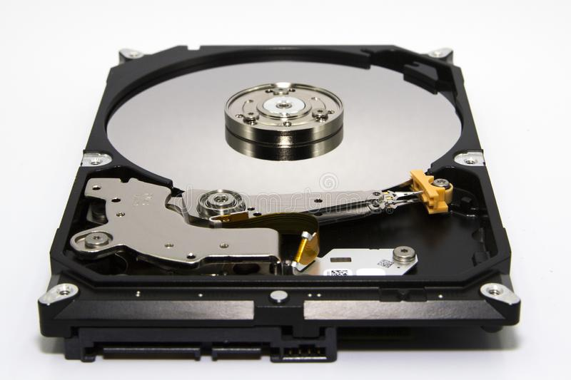 Open Hard Disk Drive  on a white background. A studio shot of a open Hard Disk Drive  on a white background royalty free stock photo