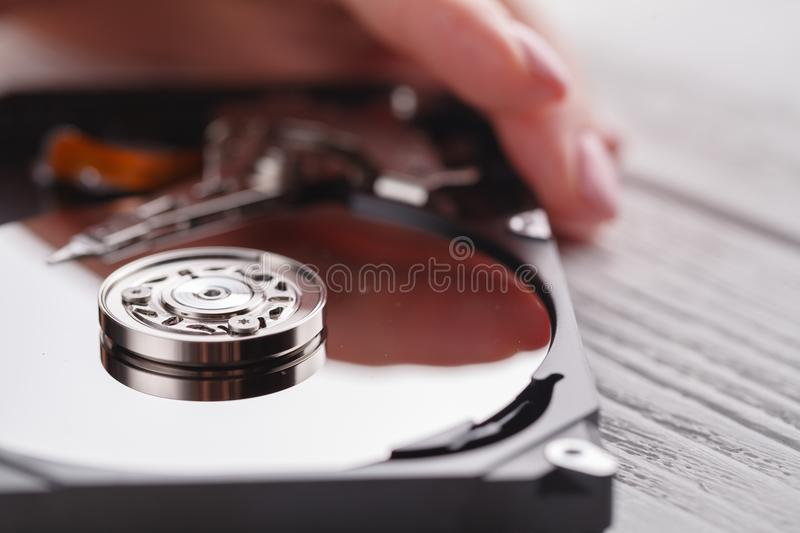 Open hard disk in female hands stock photos