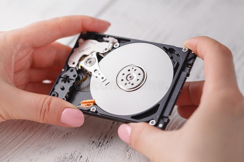 Open hard disk in female hands royalty free stock photos