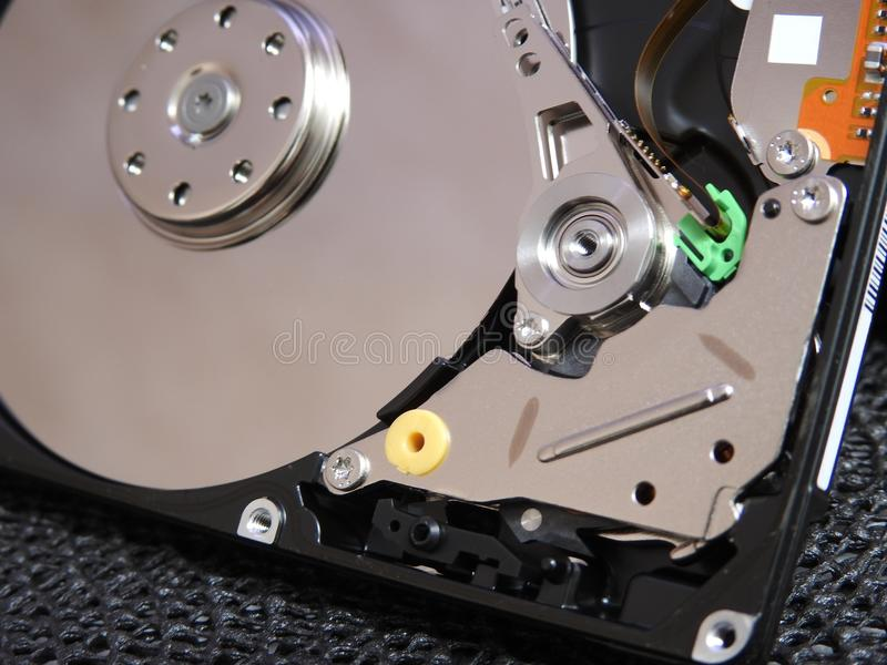 Open hard drive. With close up of write read parts stock photos
