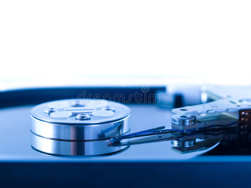 Open hard drive disk. Blue toned macro of an open hard drive disk royalty free stock photo