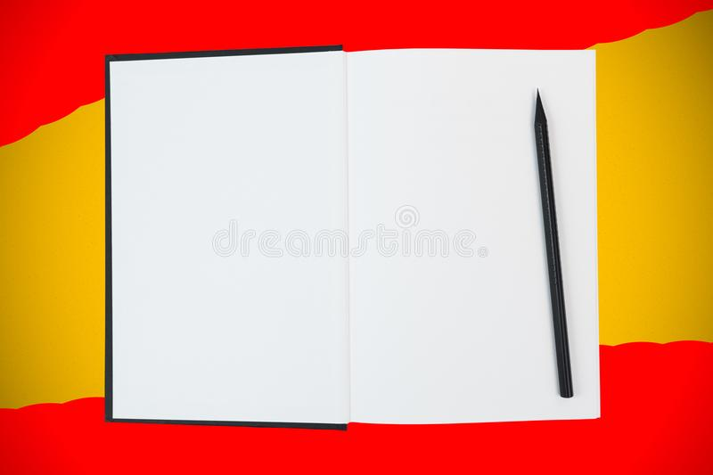Open hardcover book with blank white pages and black wooden pencil on yellow and red background. Open black hardcover book with blank white pages and wooden stock photography