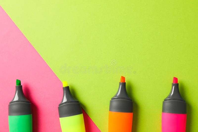 Open highlighters on two tone background. Space for text royalty free stock images