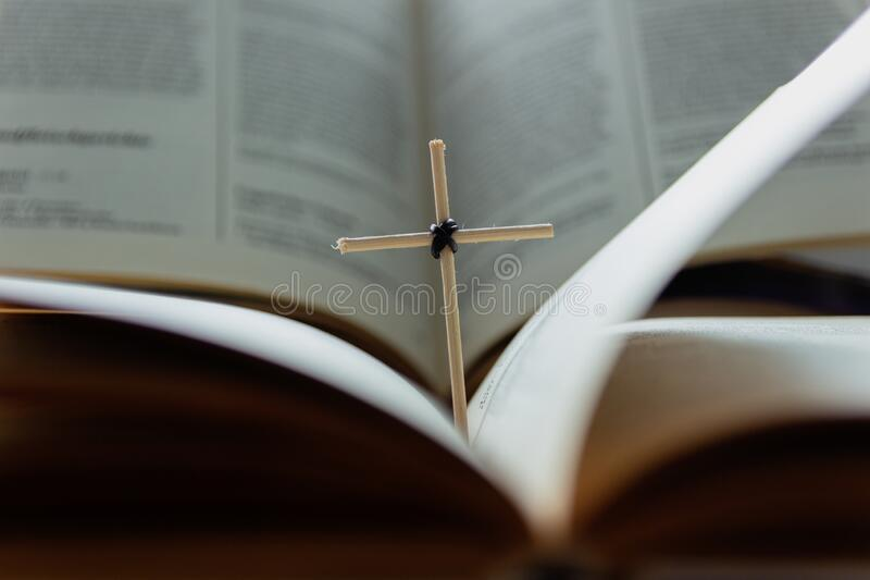 Open Holy Bible book and homemade cross. Close-up view royalty free stock photos