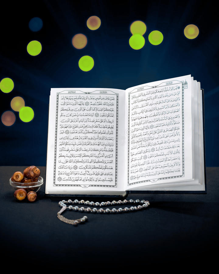 Open Holy Quran Book With Rosary and Dates royalty free stock images