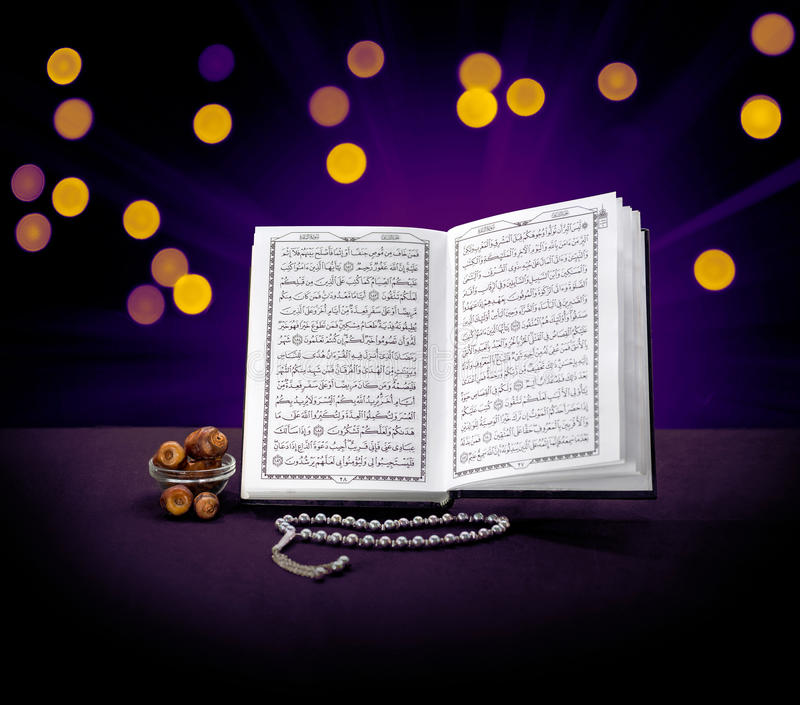 Open Holy Quran Book With Rosary and Dates royalty free stock photography