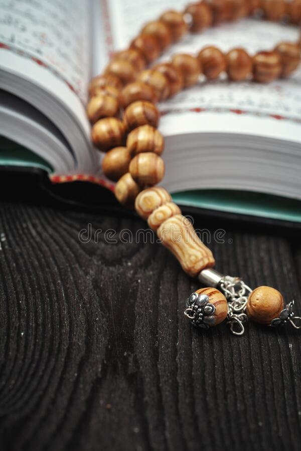 open holy quran tasbih rosary beads open holy quran tasbih rosary beads close up 173701899