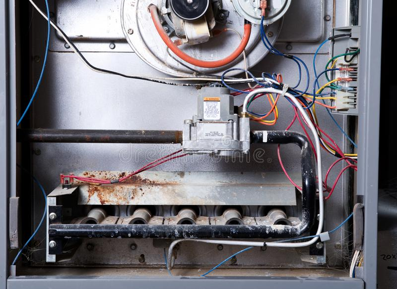 Open home furnace. Just ready for cleaning and repair stock photography