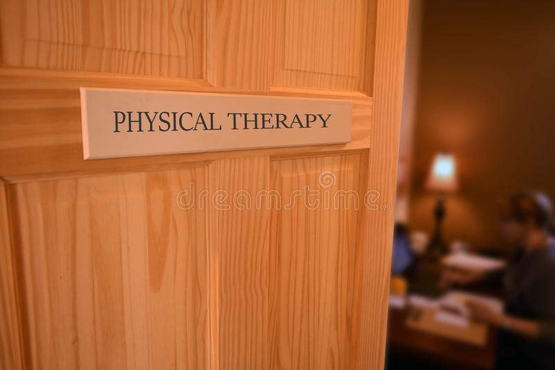 Open Hospital Door to a PHYSICAL THERAPY Room,Healthcare and pe. Ople concept royalty free stock image