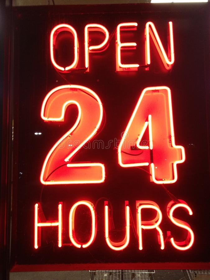 Open 24 Hours. This neon sign says it all. Sign in an eatery in Charlotte, North Carolina stock photography
