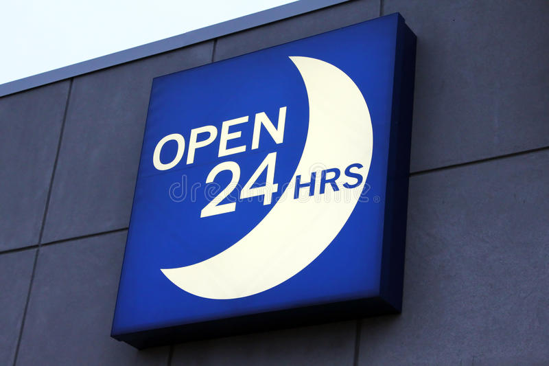 Open 24 hours sign. Illuminated blue open 24 hours sign royalty free stock photo