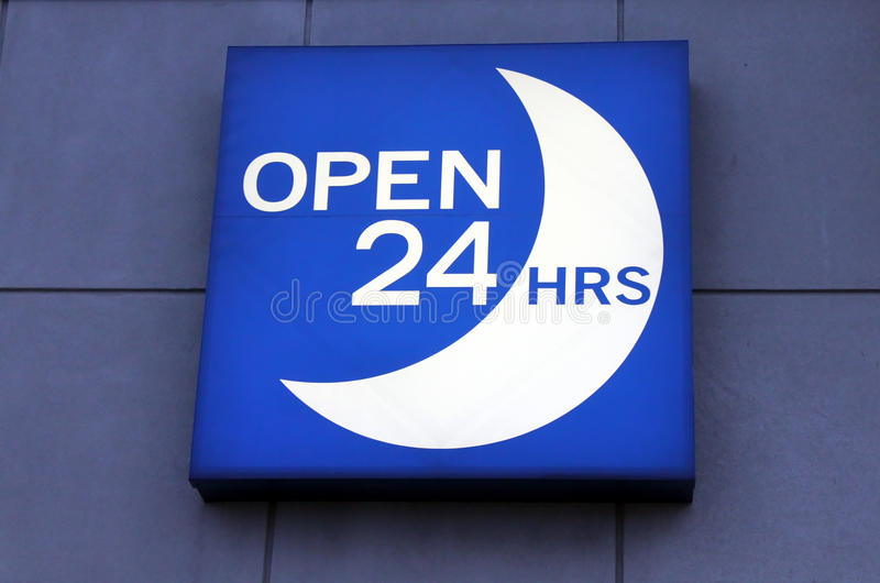 Open 24 hours sign. Illuminated blue 24 hours sign royalty free stock photo