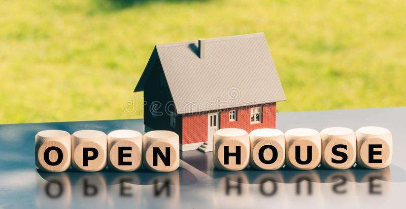 Open house concept. Cubes form the words `open house` stock photography