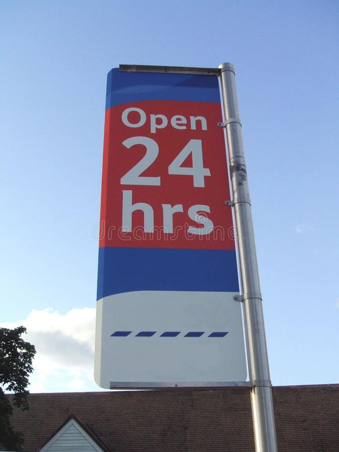 Open 24 hrs. sign. store opens all day or 24 hours sign. Sign of a place or a store that opens all day or 24 hours to serve the public stock photos