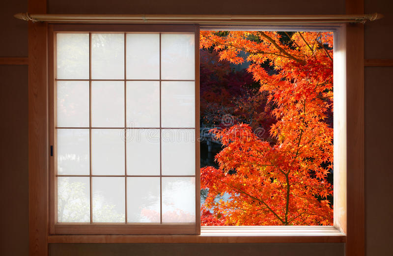 Open Japanese sliding window and bright red fall maple leaves royalty free stock images
